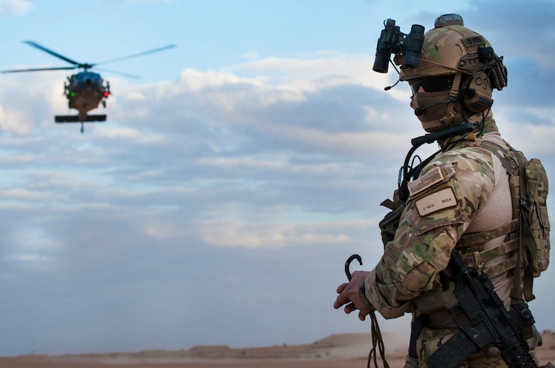 A pararescueman awaits the arrival of an HH-60G Pave Hawk helicopter assigned to the 46th Expeditionary Rescue Squadron during a training scenario November 22, 2017, in an undisclosed location. Employing air power across the region in support of Operation Inherent Resolve requires trained operators be on-alert to respond should an aircrew ever become isolated in hostile territory. (U.S. Air Force photo by Staff Sgt. Joshua Kleinholz