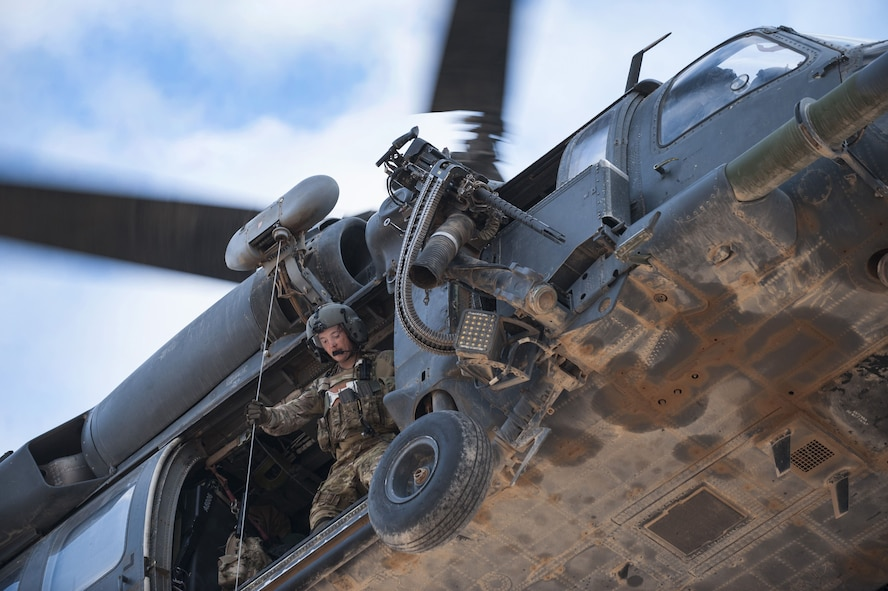 A special missions aviator assigned to 46th Expeditionary Rescue Squadron operates the hoist from an HH-60G Pave Hawk helicopter as part of a training scenario November 22, 2017, in an undisclosed location.  The 46th ERQS provides combat search and rescue capabilities across the region in support of Operation Inherent Resolve. (U.S. Air Force photo by Staff Sgt. Joshua Kleinholz)