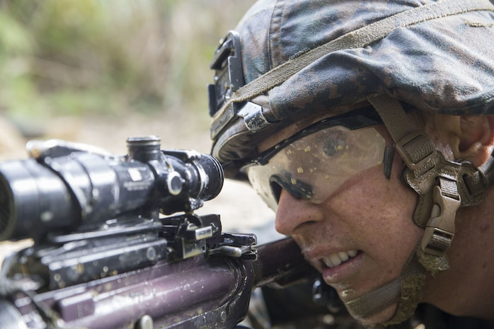 Petty Officer 1st Class Holden Hartley, a corpsman with Combat Assault Battalion, 3rd Marine Division, III Marine Expeditionary Force, provides security as his squad finishes up their objective December 6, 2017, at the Jungle Warfare Training Center in Okinawa, Japan while participating in the 3rd Marine Division Annual Squad Competition. The squads competing  are with 1st Battalion, 8th Marine Regiment; 2nd Battalion, 1st Marine Regiment; 1st Battalion, 3rd Marine Regiment and Combat Assault Battalion.  Hartley is a native to Vacaville, California.