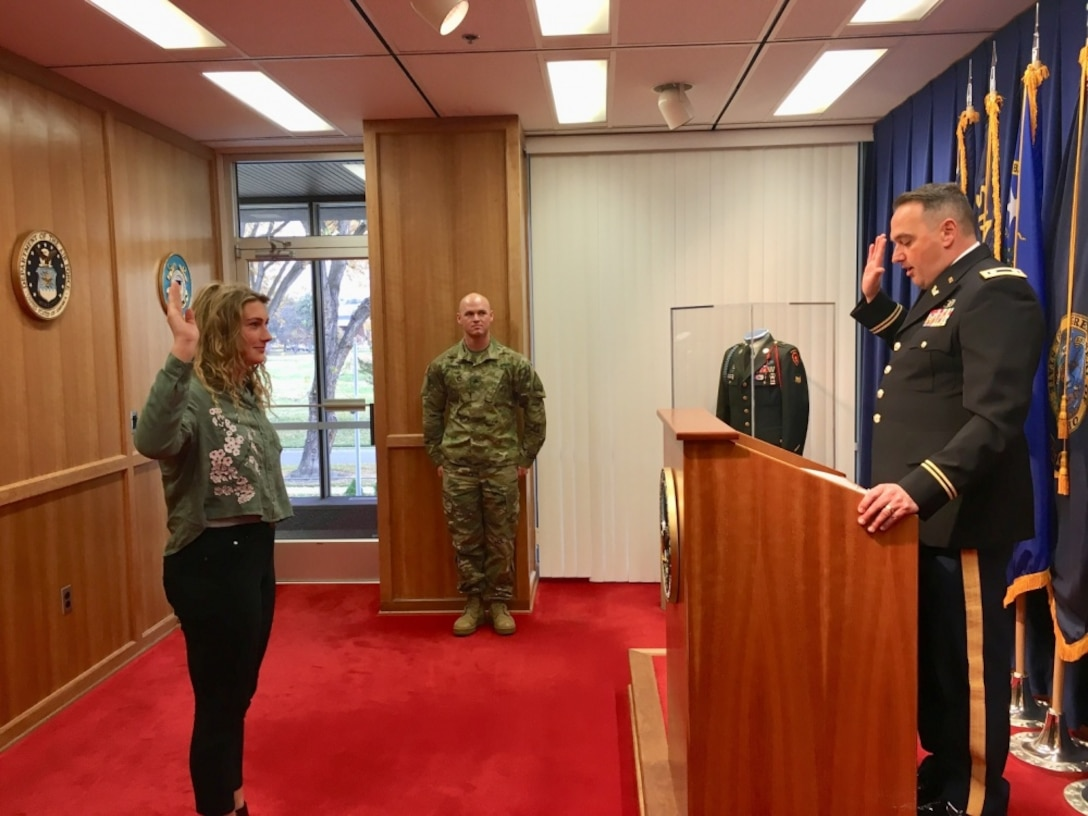 An Army officer swears in an enlistee