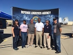 "Representatives from DLA Distribution San Diego, California, participate in the Naval Air Station North Island 100th anniversary event. (left to right: Mrs Brian Meadows, Stella Nealy, Brian Meadows, Navy Capt. Jerome R. White, Darrell ""Amos"" Moses and Navy Lt. Cmd. Brendan R. Hogan)"