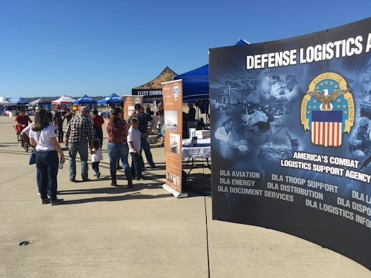 Service members, retirees, family members and guests visit the DLA Tent during the Naval Air Station North Island Centennial Celebration, on Nov. 11, 2017.