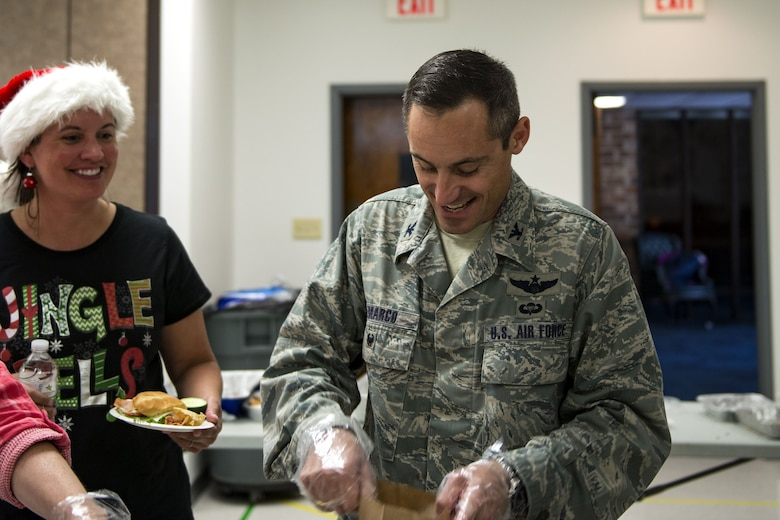 Col. Justin Demarco, 23d Wing vice commander, fills bags with cookies during the Annual Moody Airmen Cookie Drive, Dec. 4, 2017, at Moody Air Force Base, Ga. Local organizations, Airmen and spouses donated more than 8,000 cookies to approximately 700 dorm residents to show appreciation for the Airmen during the holidays. (U.S. Air Force photo by Airman 1st Class Erick Requadt)