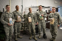 Airmen assigned to the 23d Communications Squadron pose for a photo during the Annual Moody Airmen Cookie Drive, Dec. 5, 2017, at Moody Air Force Base, Ga. Local organizations, Airmen and spouses donated more than 8,000 cookies to approximately 700 dorm residents to show appreciation for the Airmen during the holidays. (U.S. Air Force photo by Airman 1st Class Erick Requadt)
