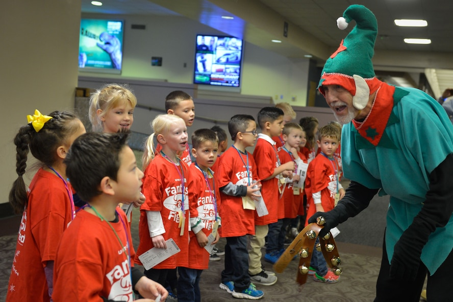 Children from Luke Air Force Base sing a Christmas song while being entertained by volunteers during the United Fantasy Flight at the Phoenix Sky Harbor International Airport in Phoenix Ariz., Dec. 1, 2017. Dozens of children from around Phoenix received shoes, sweatshirts, blankets, toys, books and a tablet courtesy of United Airlines. (U.S. Air Force photo/Senior Airman Devante Williams)