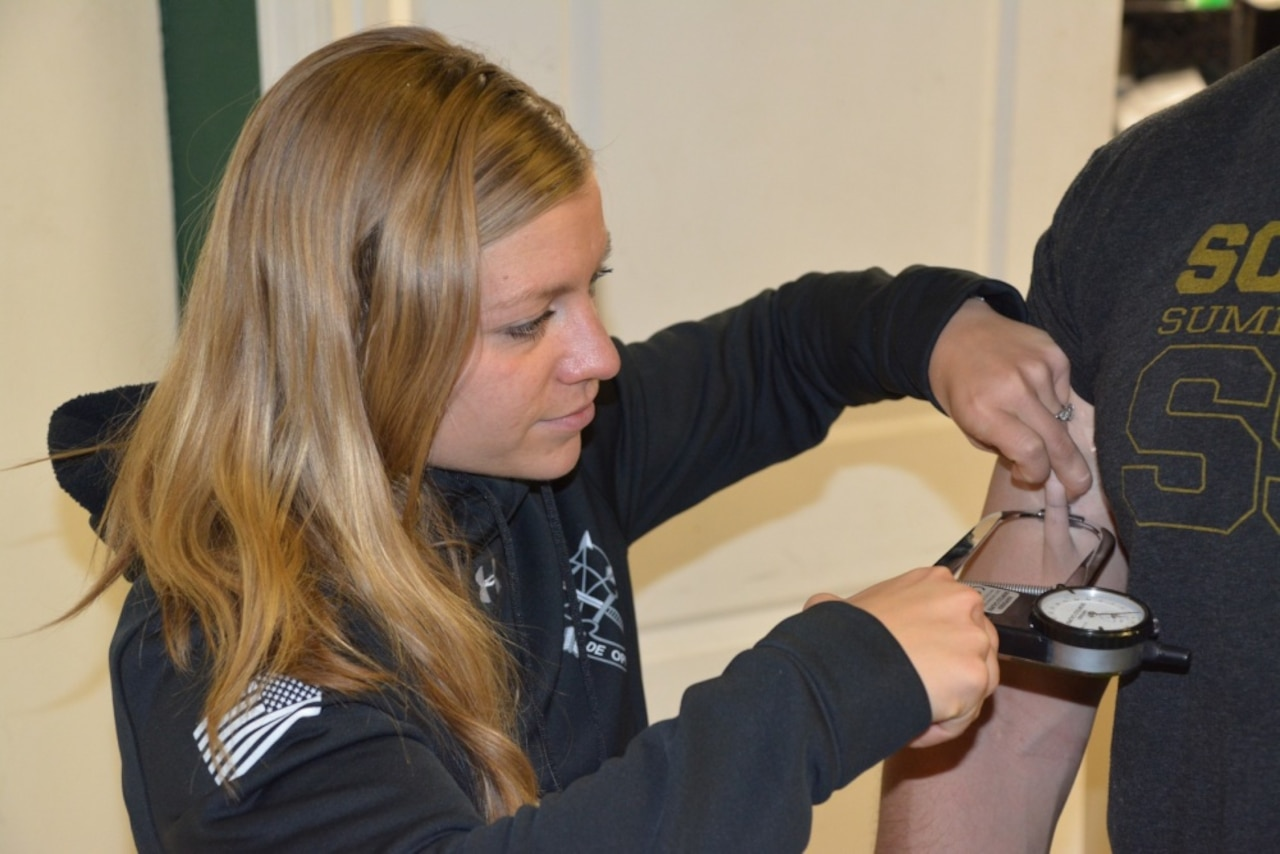 A performance dietitian measures body composition