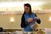Jeannie Mooney packs cookies during the annual Airmen Cookie Drive Dec. 4, 2017, at Seymour Johnson Air Force Base, North Carolina.