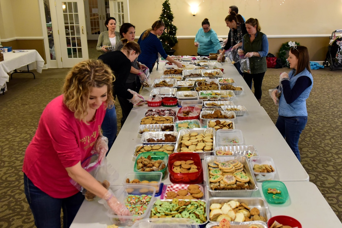 Members of Team Seymour pack donated cookies during the annual Officer and Civilian Spouses Club Airmen Cookie Drive Dec. 4, 2017, at Seymour Johnson Air Force Base, North Carolina.
