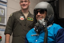 Urijah Faber, former Ultimate Fighting Championship bantamweight fighter, uses a flight simulator at 1st Operations Group aerospace and operational physiology during the Mixed Martial Arts Legends Tour at Joint Base Langley-Eustis, Va., Dec. 1, 2017.
