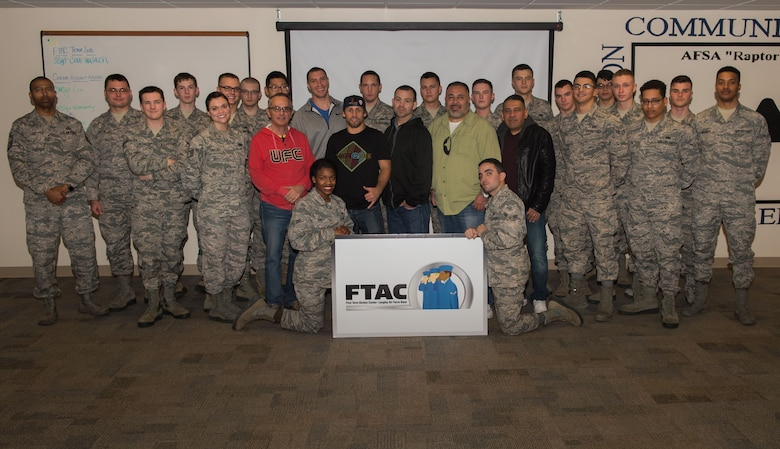 U.S. Air Force Airmen and leadership from the First Term Airman Course pose for a photo with Ultimate Fighting Championship fighters, UFC's creator and Mixed Martial Arts junkie radio hosts during the MMA Legends Tour at Joint Base Langley-Eustis, Va., Dec. 1, 2017.