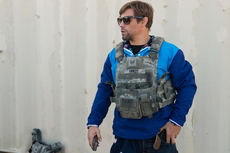 Urijah Faber, former Ultimate Fighting Championship bantamweight fighter, tries on a bulletproof vest during the Mixed Martial Arts Legends Tour at Joint Base Langley-Eustis, Va., Dec. 1, 2017.