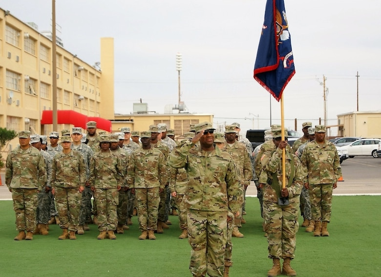 Lt. Col. Adrian Jackson salutes as he leads the incoming 7th Personnel Service Battalion, 95th Regiment, 4th Brigade, 94th Training Division, 80th Training Command formation at the CONUS Replacement Center Transfer of Authority ceremony at Fort Bliss, Texas, Dec. 1, 2017.