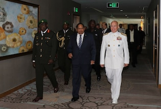 Military leaders walk together in Guyana.