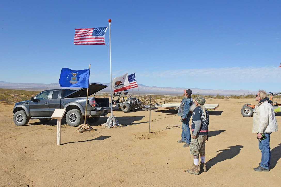 Cal City VFW post refreshes flag at flying wing crash site