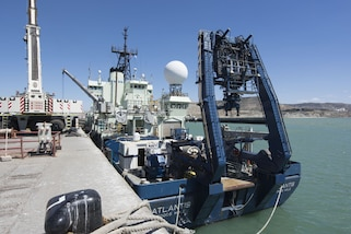 A ship is loaded with the cable-controlled Undersea Recovery Vehicle.