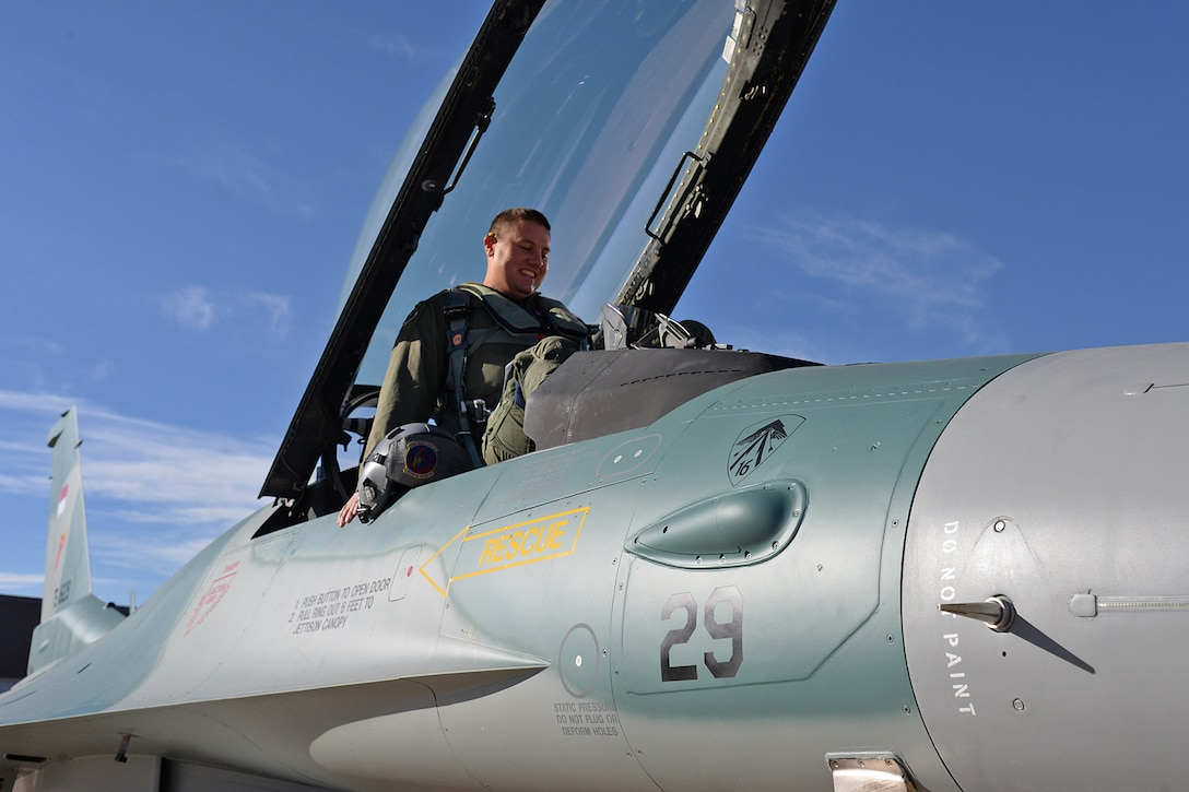 "Lt. Col. Beau ""Strap"" Wilkins, 514th Flight Test Squadron, climbs into the cockpit of an Indonesian F-16C Fighting Falcon Nov. 21, 2017, at Hill Air Force Base, Utah. Wilkins conducted a functional check flight on the jet to ensure the overhaul and upgrades completed on the aircraft worked properly. (U.S. Air Force photo by Alex R. Lloyd)"
