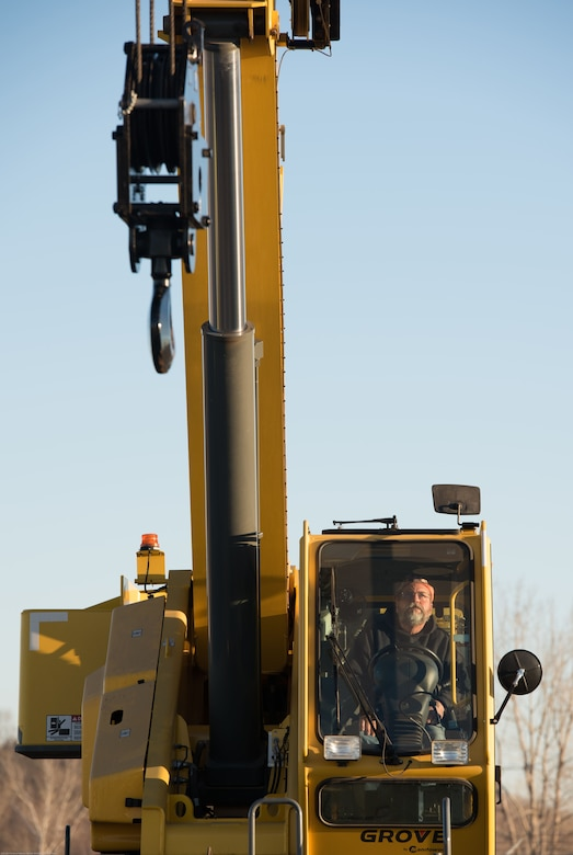 Tim Luscom, 55th Civil Engineer Squadron engineering equipment operator, controls a crane to replace Offutt Air Force Base's (AFB) legacy Tactical Air Navigation System (TACAN) at Offutt AFB, Nebraska, Nov. 29, 2017.
