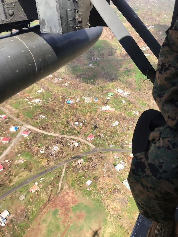 U.S. service members fly over the Caribbean island of Dominica, Oct. 9, 2017.