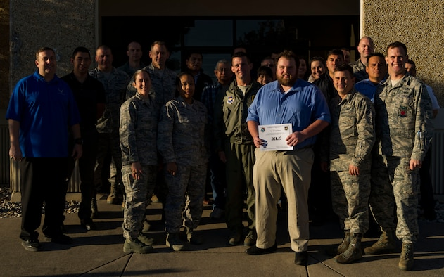 """Michael Honey, 47th Civil Engineer Squadron electrical engineer was chosen by wing leadership to be """"XLer of the week"""", for the week of Nov. 22, 2017. The """"XLer"""" award, presented by Col. Charlie Velino, 47th Flying Training Wing commander is given to those who consistently make outstanding contributions to their unit and the Laughlin mission."""