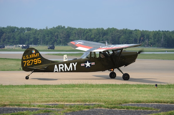 US Army Cessna O-1, serial # 57-2795 (N32FL) taxis on the grass at Ft. Campbell, KY during the Army Aviation Heritage Foundation's 'Rescue at Dawn' Vietnam-era downed pilot scenario.