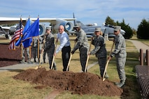 Participants in the groundbreaking for the 75th Anniversary Time Capsule were, from left, JROTC Cadet Col. Avery Stout, with Carl Albert High School and representing a future Airman; retired Air Force Lt. Col. Steve Auchter, with Tinker Heritage Foundation; 72nd Air Base Wing Commander Col. Kenyon Bell; 72nd ABW Command Chief Master Sgt. Melissa Erb; and Airman 1st Class Alexander Williams, with the 72nd Medical Group and representing the youngest Airman.