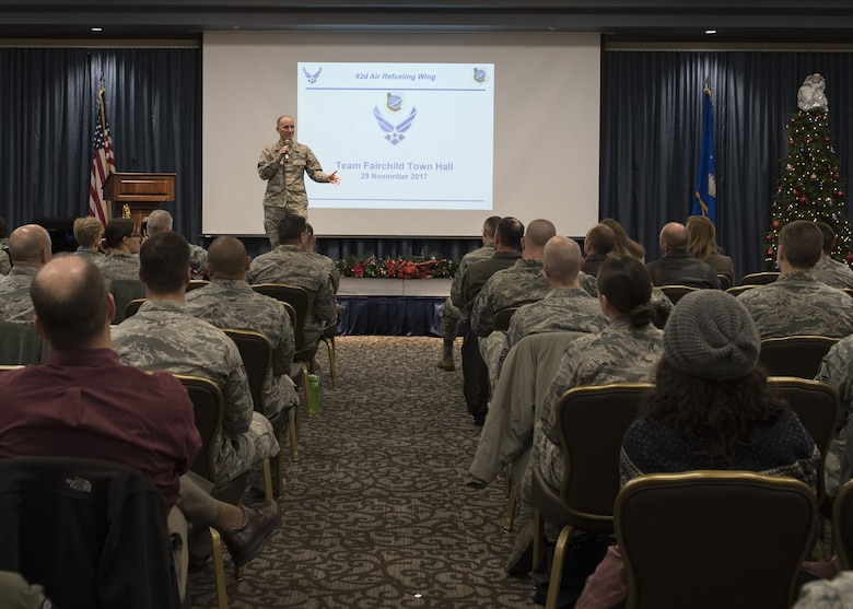Col. Ryan Samuelson, 92nd Air Refueling Wing commander, kicks off the base town hall meeting at the Red Morgan Center, Fairchild Air Force Base, Washington, Nov. 29, 2017. The town hall meeting gives base leadership an opportunity to address quality-of-life topics that affect base members and their families. (U.S. Air Force photo/Senior Airman Ryan Lackey)