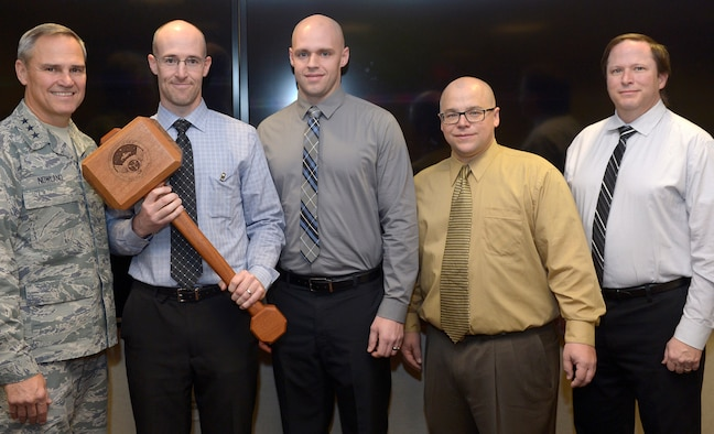 The 25th Operational Weather Squadron /Training team awarded Thor's Hammer Trophy