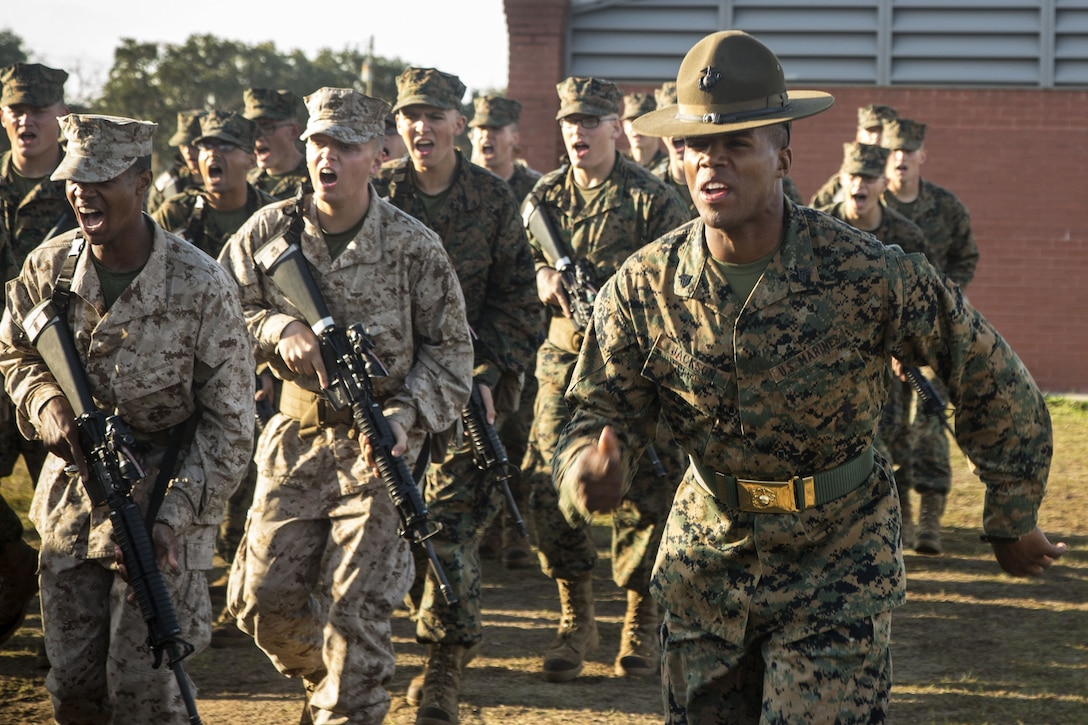 A Marine drill instructor leads his platoon.