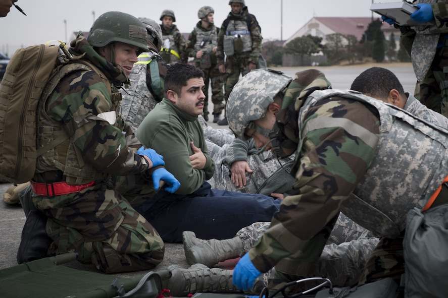 Simulated victims of a missile attack are prepared for transportation by members of the 374th Medical Squadron during exercise Beverly Morning 17-08 in conjunction with exercise Vigilant Ace 18, Dec. 4, 2017, at Yokota Air Base, Japan.