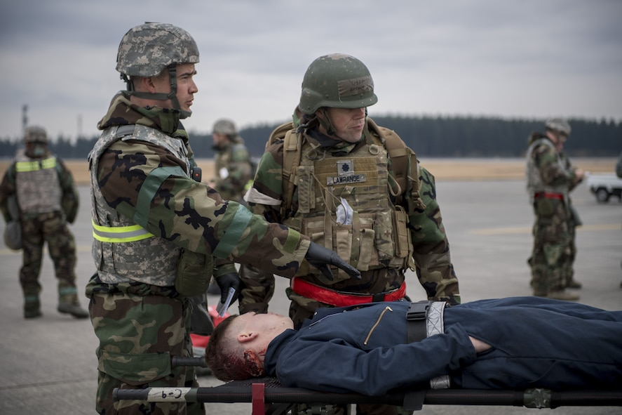 A 374th Medical Squadron medic explains the condition of a simulated victim to an on scene doctor during exercise Beverly Morning 17-08 in conjunction with exercise Vigilant Ace 18, Dec. 4, 2017, at Yokota Air Base, Japan.