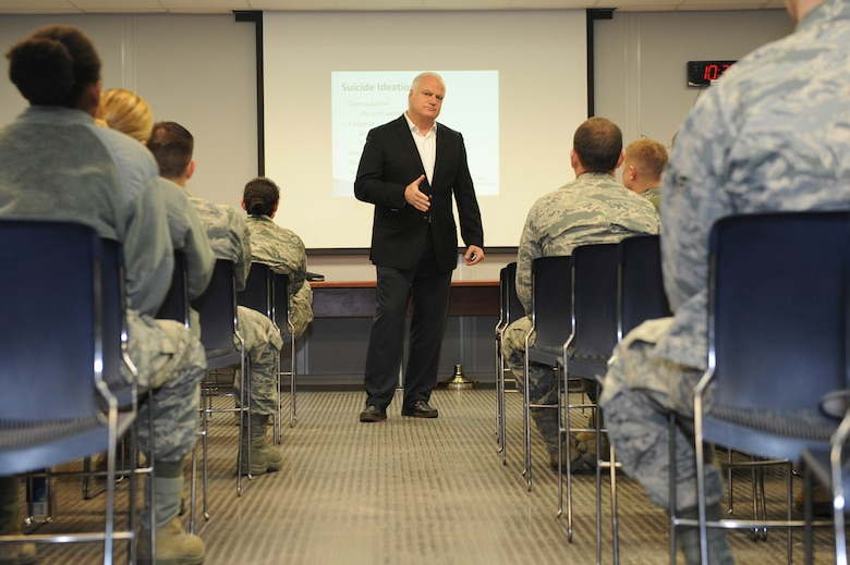 Eric Hipple, former Detroit Lions quarterback, speaks to Airmen about suicide prevention at Minot Air Force Base, N.D., Nov. 28, 2017. Since the loss of his son to suicide in 2000, Hipple travels the country to educate people about suicide prevention, depression and mental health. (U.S. Air Force photo by Airman 1st Class Jessica Weissman)