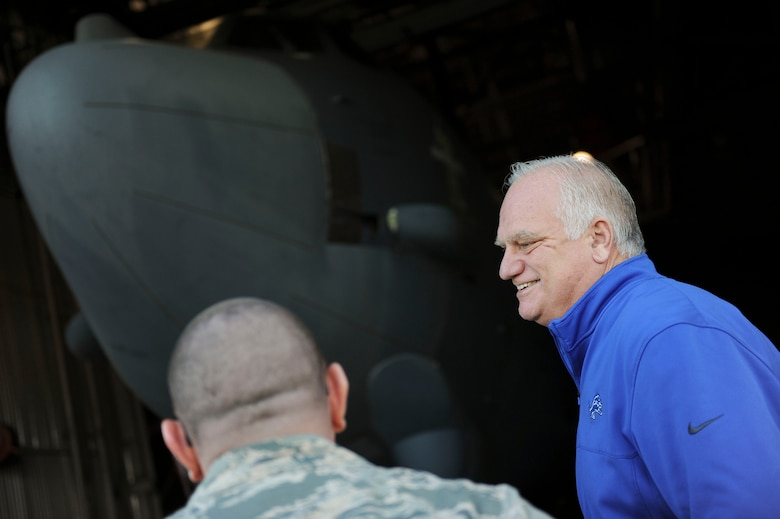 Eric Hipple, former Detroit Lions quarterback, tours a static B-52H Stratofortress at Minot Air Force Base, N.D., Nov. 28, 2017. After a decade-long football career, Hipple has committed himself to educating various military units, corporations and schools about mental health issues. (U.S. Air Force photo by Airman 1st Class Jessica Weissman)