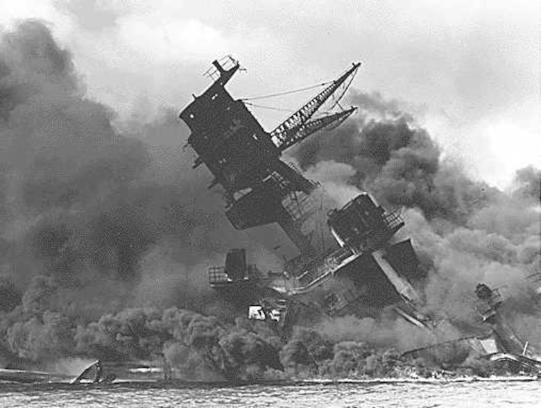 This photo, provided by the Robins Air Force Base History Office shows the USS Arizona coming under attack at Pearl Harbor. (Robins History Office Photo)