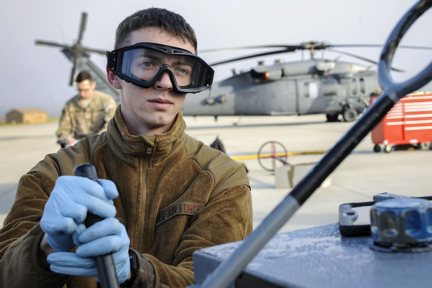 Senior Airman Nicholas Dacyk, 723d Aircraft Maintenance Squadron hydraulics systems apprentice, pulls a lever attached to an HH-60G Pave Hawk, Dec. 5, 2017, at Moody Air Force Base, Ga. As part of a Phase 1, Phase 2 exercise, the 23d Wing is evaluating its operations, maintenance and logistics to determine its readiness to rapidly deploy. Airmen from the 723d Aircraft Maintenance Squadron folded the main and tail rotor blades inward to make it easier to transport and then unfolded the rotors to practice making the helicopter operational. (U.S. Air Force photo by Airman Eugene Oliver)