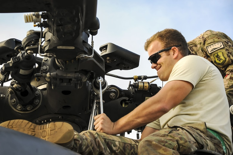 Staff Sgt. Justin Willis, 723d Aircraft Maintenance Squadron crew chief, tightens a screw on the rotor of an HH-60G Pave Hawk, Dec. 5, 2017, at Moody Air Force Base, Ga. As part of a Phase 1, Phase 2 exercise, the 23d Wing is evaluating its operations, maintenance and logistics to determine its readiness to rapidly deploy. Airmen from the 723d Aircraft Maintenance Squadron folded the main and tail rotor blades inward to make it easier to transport and then unfolded the rotors to practice making the helicopter operational. (U.S. Air Force photo by Airman Eugene Oliver)