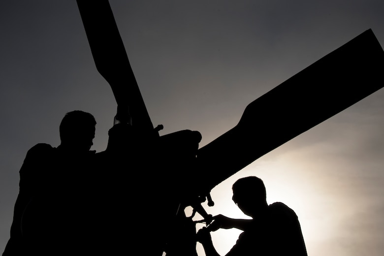 Senior Airman Greggory Petkewicz, and Senior Airman Trevor Krutsch, 723d Aircraft Maintenance Squadron crew chiefs, work on the rotor of an HH-60G Pave Hawk, Dec. 5, 2017, at Moody Air Force Base, Ga. As part of a Phase 1, Phase 2 exercise, the 23d Wing is evaluating its operations, maintenance and logistics to determine its readiness to rapidly deploy. Airmen from the 723d Aircraft Maintenance Squadron folded the main and tail rotor blades inward to make it easier to transport and then unfolded the rotors to practice making the helicopter operational. (U.S. Air Force photo by Airman Eugene Oliver)