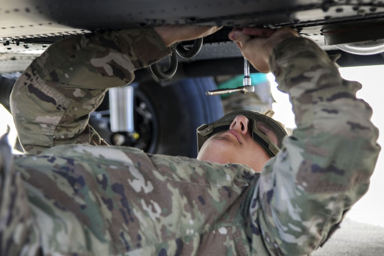 Senior Airman Greggory Petkewicz, 723d Aircraft Maintenance Squadron crew chief, tightens a screw on a HH-60G Pave Hawk, Dec. 5, 2017, at Moody Air Force Base, Ga. As part of a Phase 1, Phase 2 exercise, the 23d Wing is evaluating its operations, maintenance and logistics to determine its readiness to rapidly deploy. Airmen from the 723d Aircraft Maintenance Squadron folded the main and tail rotor blades inward to make it easier to transport and then unfolded the rotors to practice making the helicopter operational.  (U.S. Air Force photo by Airman Eugene Oliver)