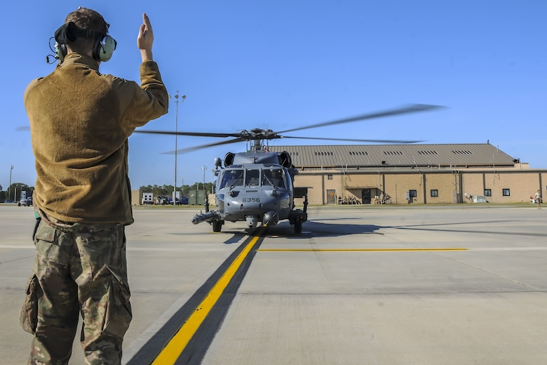 Senior Airman Nicholas Dacyk, 723d Aircraft Maintenance Squadron hydraulics systems apprentice, marshals an HH-60G Pave Hawk, Dec. 5, 2017, at Moody Air Force Base, Ga. As part of a Phase 1, Phase 2 exercise, the 23d Wing is evaluating its operations, maintenance and logistics to determine its readiness to rapidly deploy. The HH-60 capabilities were tested to determine the 723d Aircraft Maintenance Squadron's ability to make a helicopter operational. (U.S. Air Force photo by Airman Eugene Oliver)