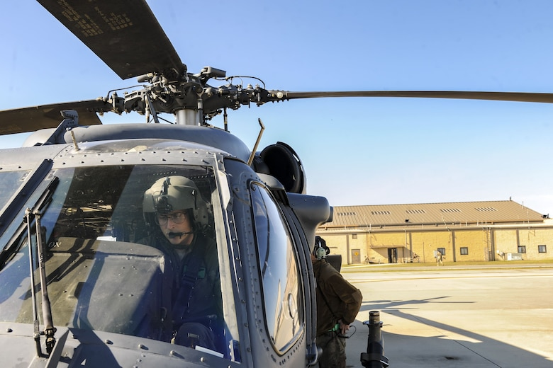 A pilot prepares to power down an HH-60G Pave Hawk following a hover test, Dec. 5, 2017, at Moody Air Force Base, Ga. As part of a Phase 1, Phase 2 exercise, the 23d Wing is evaluating its operations, maintenance and logistics to determine its readiness to rapidly deploy. The HH-60's capabilities were tested to determine the 723d Aircraft Maintenance Squadron's ability to make a helicopter operational. (U.S. Air Force photo by Airman Eugene Oliver)