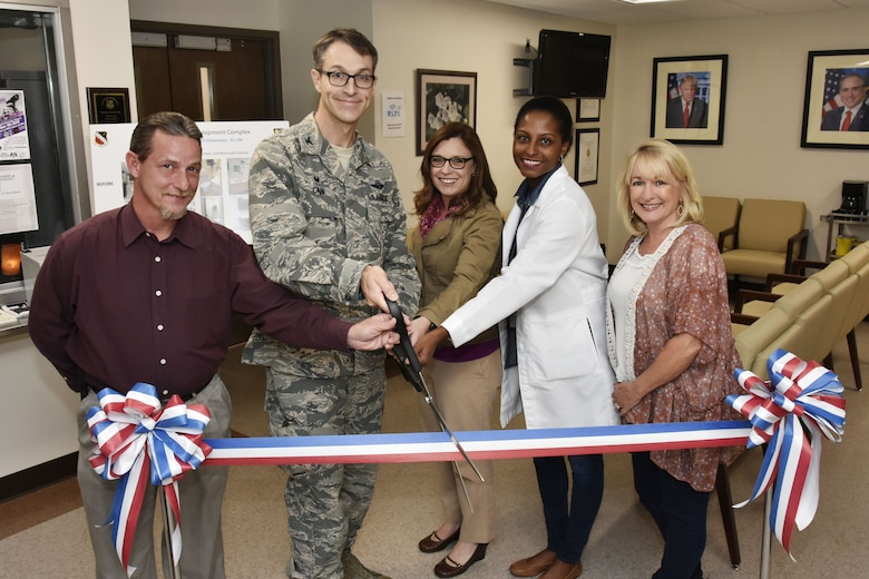 The ribbon is cut to mark the completion of renovations to the Medical Aid Station. Work included new ceilings, flooring, paint and lighting throughout the building. Pictured from left are: Medical Aid Station Chief Fred Kasper; AEDC Commander Col. Scott Cain; Test Support Division Engineering Section Project Manager Jennifer Daugherty; Dr. Tija McDaniels, physician for the Veterans Administration at Arnold AFB; and Lisa Patton, nurse practitioner for the VA at Arnold. (U.S. Air Force photo/Rick Goodfriend)