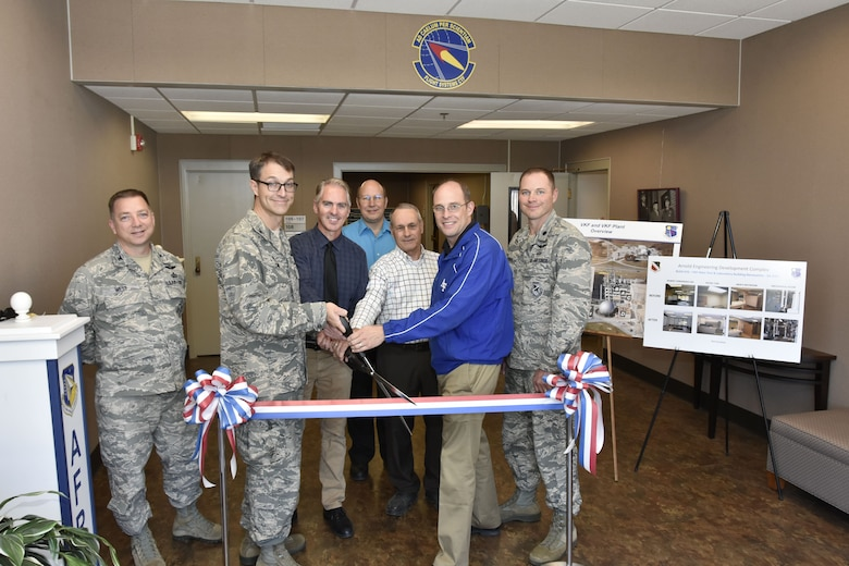The ceremonial ribbon is cut to mark the completion of renovations to the von Kármán Gas Dynamics Facility Main Test & Laboratory Building. The two-phased project consisted of HVAC replacement, fire suppression system upgrades, and improvements to facility lighting, flooring and walls. The renovation also included both mold and asbestos abatement. Pictured from left are: Col. Timothy West, chief of AEDC Test Operations Division; Col. Scott Cain, AEDC commander; Tony Pennington, Test Support Division Engineering Section project manager; Glenn Liston, chief of the High Speed Experimentation Branch; Barry Banks, NAS Construction superintendent; Lance Baxter, director of the Hypersonics Combined Test Force; and Lt. Col. David Hoffman, director of the Flight Systems CTF. (U.S. Air Force photo/Rick Goodfriend)