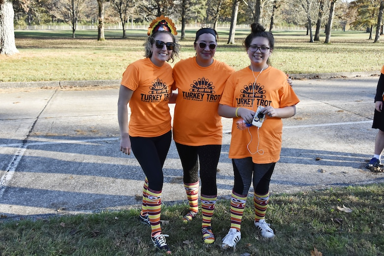 Beth Sinemus, Jory Boudreaux and Annawyn Boudreaux (pictured left to right) show off their Turkey Trot attire after crossing the finish line. The 5K run on Nov. 9 drew more than 50 participants made up of AEDC staff, their families and retirees and service members at Arnold AFB. (U.S. Air Force photo/Rick Goodfriend)