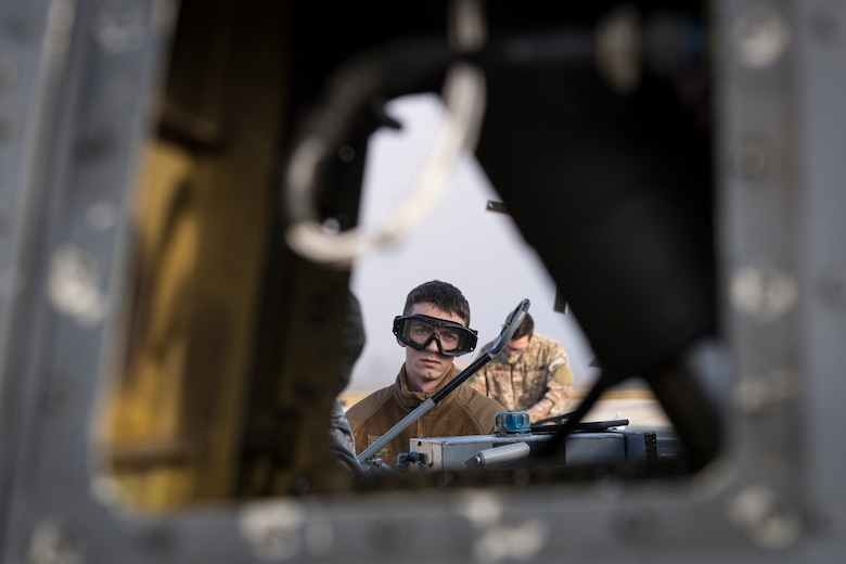 Senior Airman Nicholas Dacyk, 723d Aircraft Maintenance Squadron hydraulics systems apprentice, drains hydraulic fluid from an HH-60G Pave Hawk during an exercise, Dec. 5, 2017, at Moody Air Force Base, Ga. Moody's Phase 1, Phase 2 exercise tested the 23d Wing's ability to prepare, deploy and execute their mission at a moment's notice. The 723d AMXS was tasked with folding HH-60s in preparation for transport in a larger aircraft and unfolding them once they arrive at their final destination. During folding, the rotor blades are revolved and aligned with the body of the helicopter, and fastened into place. (U.S. Air Force photo by Senior Airman Janiqua P. Robinson)