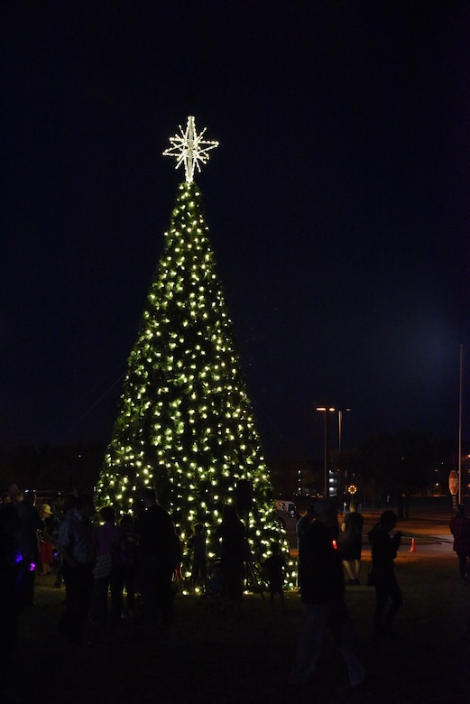 A crowd stands around the tree during the Tree Lighting Ceremony at the Parade Field on Goodfellow Air Force Base, Texas, Dec. 4, 2017. The event had activities for children such as making decorations or cookies as well as Olaf from the Disney movie Frozen, U.S. Air Force Col. Jeffrey Sorrell, 17th Training Wing vice commander, and Santa Claus.
