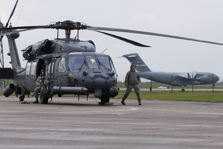 Members of the 56th Rescue Squadron conduct post-flight inspections on an HH-60G Pave Hawk at Royal Air Force Lakenheath, England, Nov. 19, 2017. The 56th RQS aircrews spend approximately 350 hours a year training to safely conduct missions. (U.S. Air Force photo/Senior Airman Malcolm Mayfield)