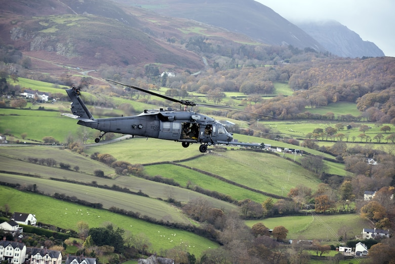 An HH-60G Pave Hawk from the 56th Rescue Squadron flies above Wales Nov. 20, 2017. The 56th RQS provides humanitarian assistance, non-combatant evacuation and disaster relief capability for the U.S. European Command combatant commander and the Joint Chiefs of Staff in peacetime. (U.S. Air Force photo/Senior Airman Malcolm Mayfield)