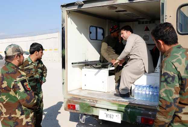 Members of the Afghan National Army transport family members and two recovering children back to their home.