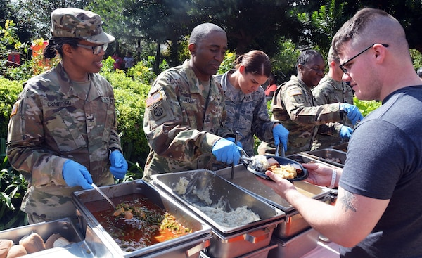 Brooke Army Medical Center deputy commanding officer Col. Traci Crawford and Command Sgt. Maj. Diamond Hough serve a Thanksgiving-style feast to Warrior Transition Battalion Soldiers and their families Nov. 17 at the Warrior and Family Support Center at Joint Base San Antonio-Fort Sam Houston.