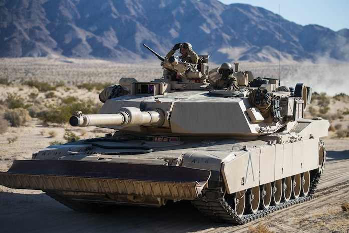 U.S. Marines with Alpha Company, 1st Tank Battalion, 1st Marine Division, arrives at Tactical Assembly Area Abrams in an M1A1 Abrams tank during exercise Steel Knight 2018 at Marine Corps Air Ground Combat Center, Twentynine Palms, Calif., Dec. 4, 2017.