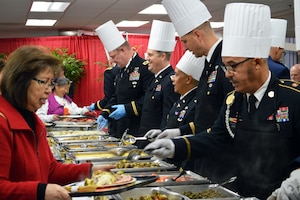 Members of the Brooke Army Medical Center command staff serve Thanksgiving dinner to more than 1,000 guests Nov. 23 in the BAMC Dining Room at Joint Base San Antonio-Fort Sam Houston.